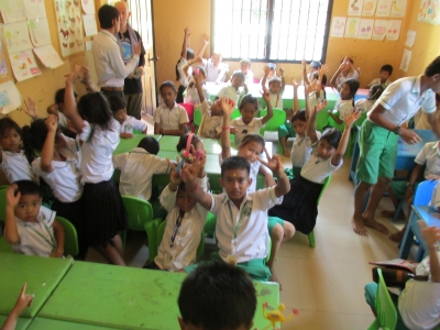 Mary Kelly learning from Cambodian children
