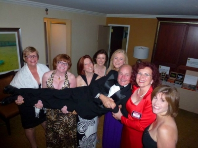 Debbie Adams, Brandy Graybill, Kirsten Carey, Stephanie Vance, Mary Kelly and Lanie Goldberg giving Ed Rigsbee a lift