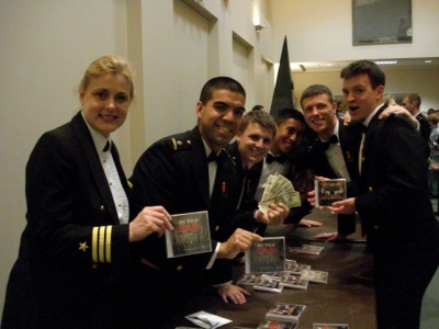 CDR Mary Kelly with USNA Men's Glee Club on tour