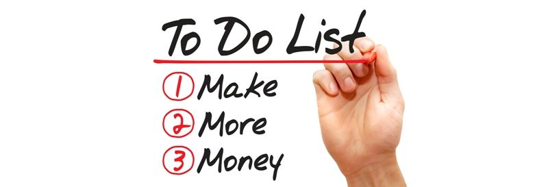 Hand writing Make More Money in To Do List with red marker